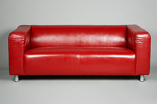 Megan Fox Leather Couch. a bright red leather couch
